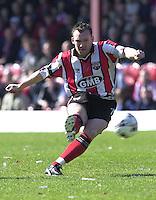 .Photo Peter Spurrier.06/04/2002.Nationwide Div 2.Brentford vs Huddersfield - Griffen Park:.Paul Evan's with a shot on goal..