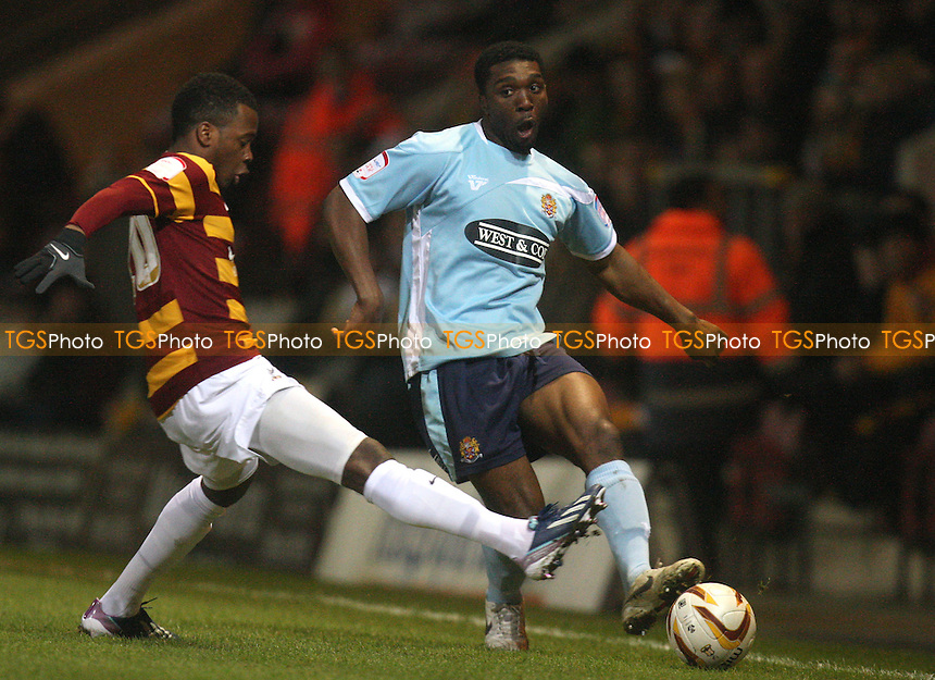 Zavon Hines of Bradford City and Oluwafemi Ilesanmi of Dagenham - Bradford City vs Dagenham at the Coral Windows Stadium - 27/02/13 - MANDATORY CREDIT: Dave Simpson/TGSPHOTO - Self billing applies where appropriate - 0845 094 6026 - contact@tgsphoto.co.uk - NO UNPAID USE.
