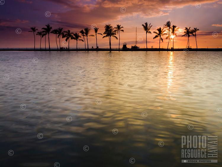 Sunset at 'Anaeho'omalu Bay, as seen from the Ku'uali'i fishpond, Waikoloa, Big Island.