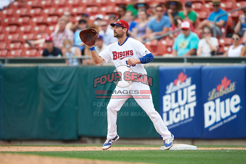 Buffalo Bisons first baseman Casey Kotchman (55) stretches for a throw during a game against the Louisville Bats on June 23, 2016 at Coca-Cola Field in Buffalo, New York.  Buffalo defeated Louisville 9-6.  (Mike Janes/Four Seam Images)