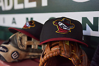 A Quad Cities River Bandits hats sits in the dugout during a Midwest League game between the Bandits and Fort Wayne TinCaps at Parkview Field on May 3, 2019 in Fort Wayne, Indiana. Quad Cities defeated Fort Wayne 4-3. (Zachary Lucy/Four Seam Images)