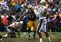 Green Bay Packers defensive end Reggie White bears down on San Francisco 49er quarterback Elvis Grbac in the 1996-97 NFC Divisional Playoff game at Lambeau Field on January 4, 1997. The Packers won the contest 35-14.
