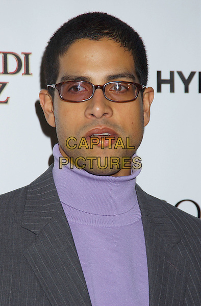 ADAM RODRIQUEZ.Movieline's Hollywood Life Honors 2004 Breakthrough Awards held at the Henry Fonda Music Box Theatre. .December 12th, 2004.headshot, portrait, sunglasses, shades, tinted glasses, turtleneck, polo neck.www.capitalpictures.com.sales@capitalpictures.com.© Capital Pictures.