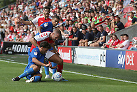 Fleetwood Town's Tommy Spurr battles with Wimbledon's Will Nightingale and Tennai Watson<br /> <br /> Photographer Stephen White/CameraSport<br /> <br /> The EFL Sky Bet League One - Fleetwood Town v AFC Wimbledon - Saturday 4th August 2018 - Highbury Stadium - Fleetwood<br /> <br /> World Copyright &copy; 2018 CameraSport. All rights reserved. 43 Linden Ave. Countesthorpe. Leicester. England. LE8 5PG - Tel: +44 (0) 116 277 4147 - admin@camerasport.com - www.camerasport.com