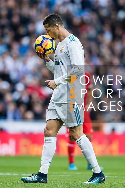 Cristiano Ronaldo of Real Madrid kisses the ball during the La Liga 2017-18 match between Real Madrid and Sevilla FC at Santiago Bernabeu Stadium on 09 December 2017 in Madrid, Spain. Photo by Diego Souto / Power Sport Images