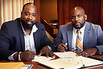 WATERBURY CT. 07 Augusr 2017-080717SV02-From left, Marcus Stallworth and Anthony Gay of Welcome 2 Reality work in their office in Waterbury Monday. <br /> Steven Valenti Republican-American