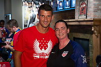 Eric Lichaj meets with a fan attending a U.S. Soccer Sunday Kick-off Series Event at Nashville Underground on Sunday, September 9, 2018 in Nashville, TN.