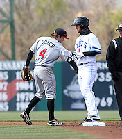 Syracuse Chiefs center fielder Bryce Harper #34 congratulated by Brian Dozier #4 after hitting a double in his first at bat during the opening game of the International League season against the Rochester Red Wings at Alliance Bank Stadium on April 5, 2012 in Syracuse, New York.  (Mike Janes/Four Seam Images)