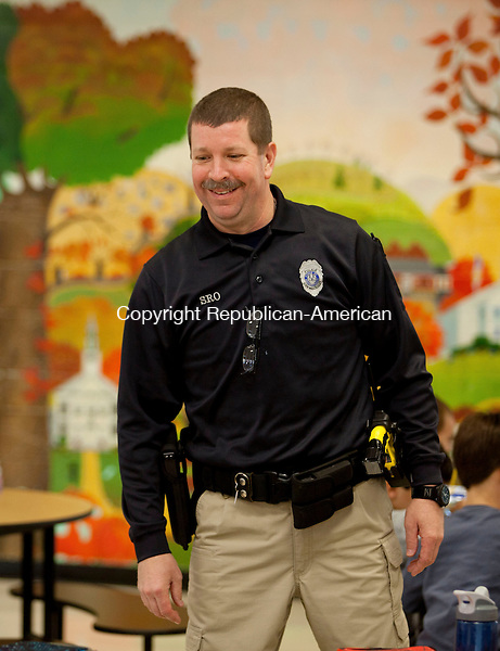 WOODBURY, CT-13 November 2013-111313BF05- School Resource Officer Craig Tibbals checks safety and visits with students and teachers daily at Mitchell Elementary School in Woodbury. Officer Craig, as he is known to students, started as the school resource officer at the school in September and is at the school each day students are present. Bob Falcetti Republican-American