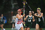 TAMPA, FL - MAY 20: Monica Sanna #5 of the Le Moyne Dolphins and Sam Keesey #23 of the Florida Southern Mocs battle for the ball during the Division II Women's Lacrosse Championship held at the Naimoli Family Athletic and Intramural Complex on the University of Tampa campus on May 20, 2018 in Tampa, Florida. Le Moyne defeated Florida Southern 16-11 for the national title. (Photo by Jamie Schwaberow/NCAA Photos via Getty Images)