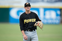 West Virginia Power shortstop Kevin Newman (5) warms up in the outfield prior to the game against the Hickory Crawdads at L.P. Frans Stadium on August 15, 2015 in Hickory, North Carolina.  The Power defeated the Crawdads 9-0.  (Brian Westerholt/Four Seam Images)