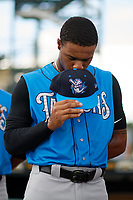 Tampa Tarpons Isiah Gilliam (24) during the national anthem before a game against the Bradenton Marauders on August 12, 2018 at LECOM Park in Bradenton, Florida.  The game was suspended in the bottom of the first inning due to weather.  (Mike Janes/Four Seam Images)