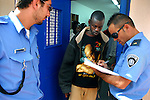 A refugee from Darfur is identified by Israeli prison guards, as he is released from Ketziot Prison, southern Israel. After illegally crossing the Israeli-Egyptian border and spending time in detention, Darfur refugees are now spread between Israeli towns and farms, which offer them job opportunities.
