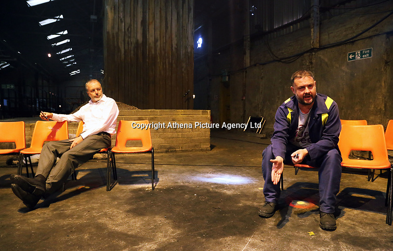 """Pictured: Actors Ioan Hefin and Simon Nehan <br /> Re: Press rehearsal of """"We'Re Still Here"""", a play created by Rachel Trezise, Common Wealth and the National Theatre Wales about steelworkers, which will be performed in Byass Works, a disused industrial unit, in Port Talbot, south Wales, UK."""