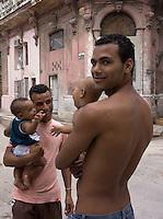 men with babies, street scene in Havana, Cuba