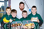 Anthony Fealey shows Killarney Monastry students Filip Macioo, Kalvin O'Sullivan, Filip Jakuvowski and Eoin O'Riordan Looney some of their five a day health tips at the KDYS Health and Wellbeing day on Friday