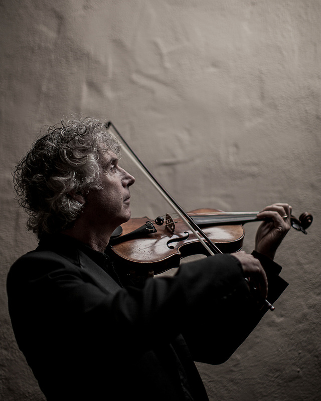 Classical violinist Edwin Huzinga practices inside the Tor House in Carmel, Calif. on Jun 3, 2018.