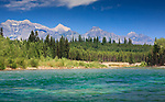 Looking across the aqua colors of the North Fork of the Flathead River into Glacier National Park and the MacDonald Mountain Range