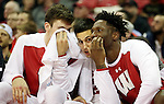 Wisconsin Badgers forward Nigel Hayes (right) chats with teammates Bronson Koenig, center, and Ethan Happ while sitting on the bench during the game with the Central Arkansas Bears at the Kohl Center.