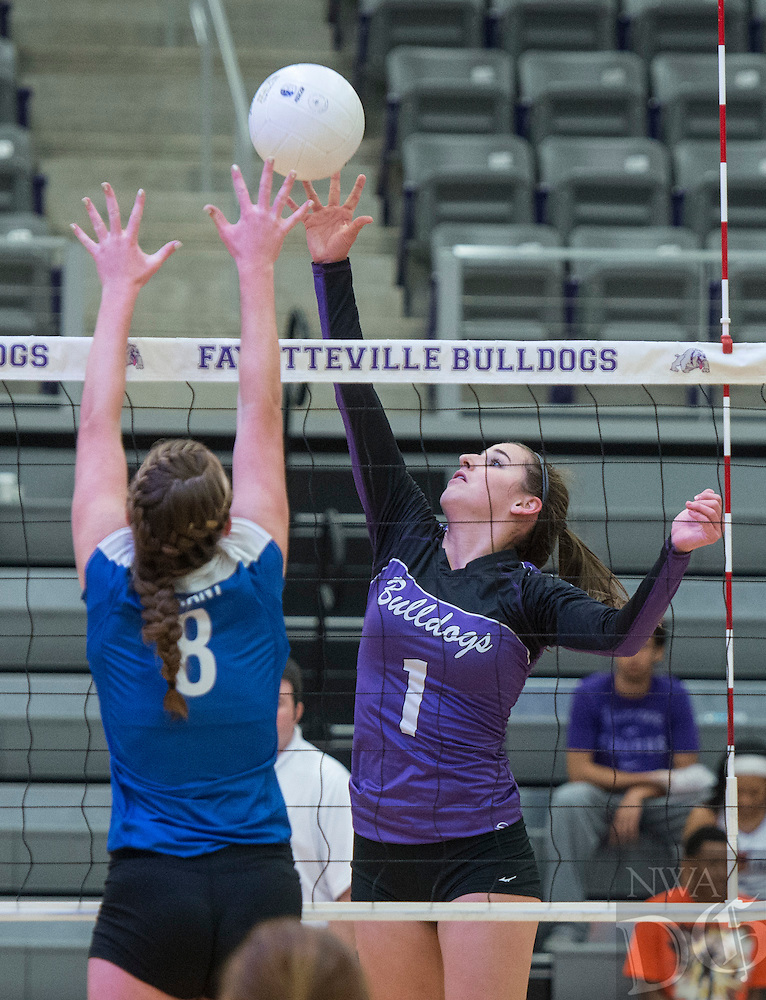 STAFF PHOTO ANTHONY REYES &bull; @NWATONYR<br /> Abbie Kathol, Fayetteville sophomore, spikes the ball against Britney Sahlmann (8) Bryant junior Tuesday, Oct. 28, 2014 during the 7A state volleyball tournament Bulldog Gymnasium. The Bulldogs won 3-1.