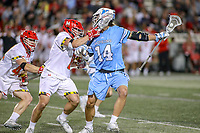 College Park, MD - April 27, 2019: John Hopkins Bluejays attack Cole Williams (14) his hit by Maryland Terrapins midfielder Roman Puglise (8) during the game between John Hopkins and Maryland at  Capital One Field at Maryland Stadium in College Park, MD.  (Photo by Elliott Brown/Media Images International)