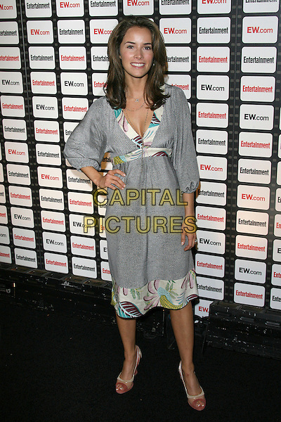 ABIGAIL SPENCER.Entertainment Weekly Magazine Celebrates the 2006 Photo Issue held at Quixote Studios, West Hollywood, California, USA..October 4th, 2006.Ref: ADM/ZL.full length grey gray dress print trim hand on hip.www.capitalpictures.com.sales@capitalpictures.com.©Zach Lipp/AdMedia/Capital Pictures.
