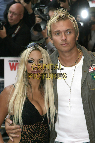 """JODIE MARSH & SCOTT WRIGHT.""""The Wedding Crashers"""" UK Film Premiere, .Odeon Cinema Leicester Square, .London, July 4th 2005..half length .Ref: AH.www.capitalpictures.com.sales@capitalpictures.com.©Adam Houghton/Capital Pictures."""