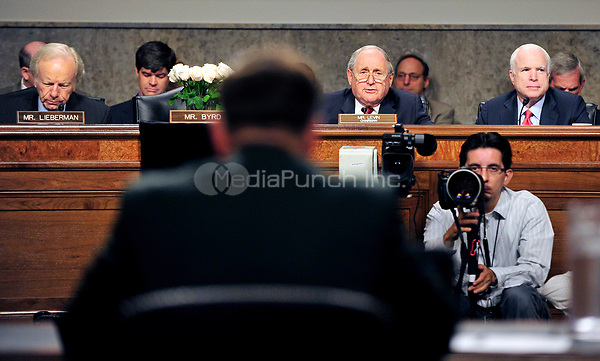 Reverse view of General David H. Petraeus, U.S. Army, testimony before the United States Senate Armed Services Committee hearing on his nomination to be commander of the International Security Assistance Force and commander of the United States Forces in Afghanistan in Washington, D.C. on Tuesday, June 29, 2010.  Pictured from left: U.S. Senator Joseph Lieberman (Independent Democrat of Connecticut); the memorial to U.S. Senator Robert Byrd (Democrat of West Virginia); U.S. Senator Carl Levin (Democrat of Michigan), General Petraeus; and U.S. Senator John McCain (Republican of Arizona)..Credit: Ron Sachs / CNP/MediaPunch