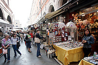 Il mercatino dei souvenir presso il Ponte di Rialto a Venezia.<br /> Tourists walk through the souvenir market of Rialto Bridge in Venice.<br /> UPDATE IMAGES PRESS/Riccardo De Luca