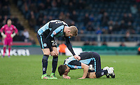 Jason McCarthy of Wycombe Wanderers checks on Matt Bloomfield of Wycombe Wanderers during the Sky Bet League 2 match between Wycombe Wanderers and Luton Town at Adams Park, High Wycombe, England on 6 February 2016. Photo by Andy Rowland.