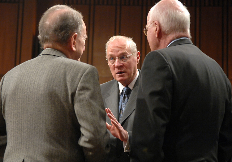 Supreme Court Justice Anthony Kennedy, center, talks with Chairman of the Senate Judiciary Committee Pat Leahy, D-Vt., right, and ranking member Arlen Specter, R-Pa., after a hearing on judicial security and independence.