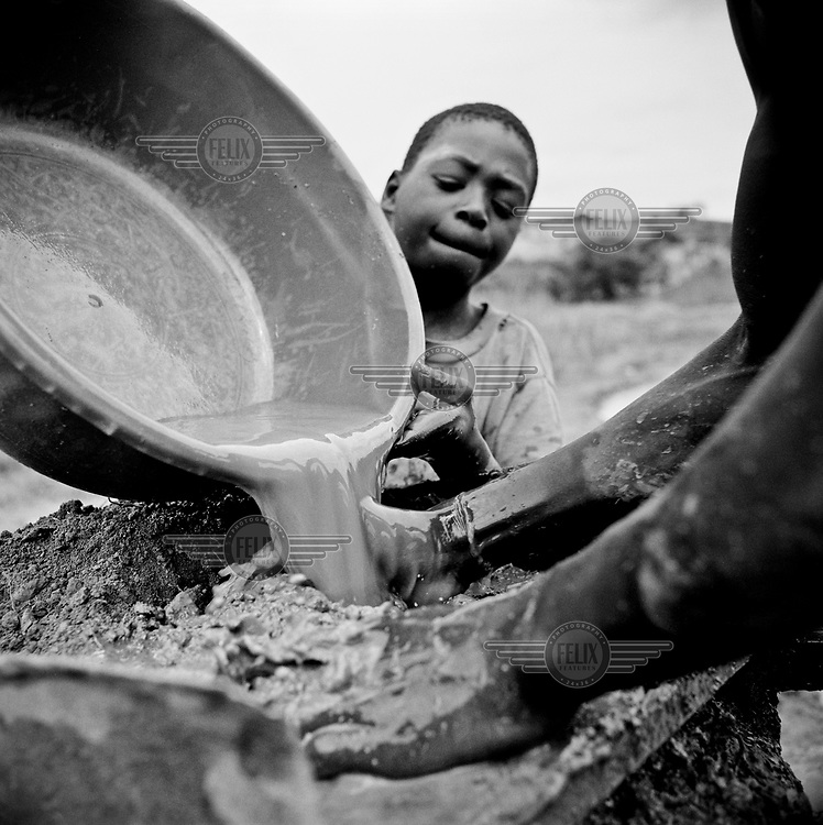 Men prospect by hand for gold.