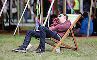 Monday 26 May 2014, Hay on Wye, UK<br /> Pictured: A man napping on a deck chair on the green.<br /> Re: The Hay Festival, Hay on Wye, Powys, Wales UK.