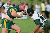 Mark Price is confronted by Manurewa's T. Ropotini. Counties Manukau Premier Club Rugby, Pukekohe v Manurewa  played at the Colin Lawrie field, on the 17th of April 2006. Manurewa won 20 - 18.