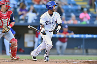Asheville Tourists second baseman Carlos Herrera (4) swings at a pitch during a game against the Hagerstown Suns at McCormick Field on June 8, 2016 in Asheville, North Carolina. The Tourists defeated the Suns 10-8. (Tony Farlow/Four Seam Images)