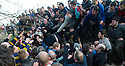 17/02/15  <br /> <br /> 'The hug' bogs down in Henmore Brook at the annual Royal Shrovetide Football  Match in Ashbourne, Derbyshire. After 'turning up' the ball at 2pm thousands of rival Up'Ards' and Down'Ards' team members attempt to 'goal' the ball onto stones set three miles apart in the town of Ashbourne, Derbyshire. The game also known as &quot;hugball&quot; has been played from at least c.1667 although the exact origins of the game are unknown but one of the most popular origin theories suggests the macabre notion that the 'ball' was originally a severed head tossed into the waiting crowd following an execution.<br /> <br /> <br /> All Rights Reserved - F Stop Press.  www.fstoppress.com. Tel: +44 (0)1335 418629 +44(0)7765 242650
