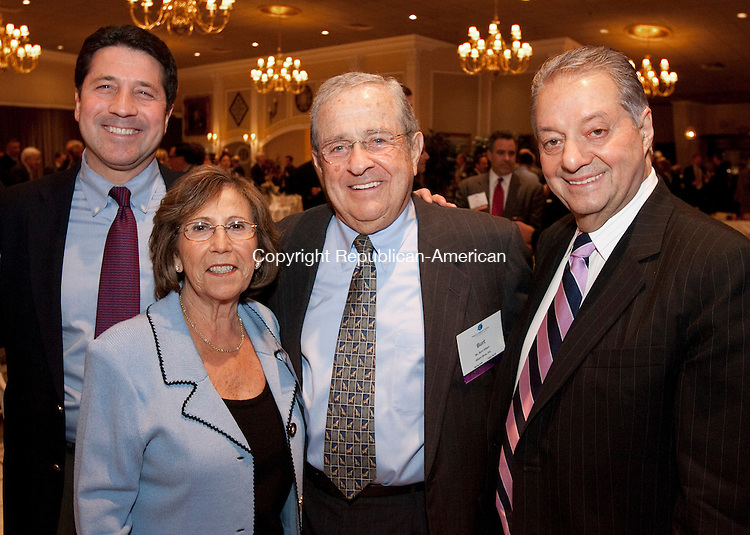 SOUTHINGTON, CT, 19 OCTOBER 2010-101910JS12-Jonathan Albert with his parents Sylvia Albert and 2009 Malcom Baldrige Award recipient Burt Albert od Albert Brothers, Inc.,  and event co-chair and  2010 recipient Carmen Anthony Vacalebre of Carmen Anthony Restaurant Group at the annual Malcolm Baldrige Awards dinner at the Aqua Turf in Southington. <br />  Jim Shannon Republican-American