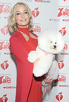 NEW YORK, NY - FEBRUARY 07: Bo Derek and Flynn the Bichon attends The American Heart Association's Go Red For Women Red Dress Collection 2019 Presented By Macy's at Hammerstein Ballroom on February 7, 2019 in New York City.     <br /> CAP/MPI/GN<br /> ©GN/MPI/Capital Pictures