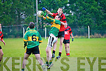 Moyvane's Kevin Fitzmaurice wins the ball from Tarbert's Ger O'Sullivan and No 6 is  James Flavin.