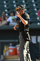 Home plate umpire Jude Koury works a game between the Rome Braves and the Columbia Fireflies on Sunday, July 2, 2017, at Spirit Communications Park in Columbia, South Carolina. Columbia won, 3-2. (Tom Priddy/Four Seam Images)