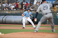 Hickory Crawdads Sam Huff (24) takes a lead off first base during a game with the Asheville Tourists at L.P. Frans Stadium on May 8, 2019 in Hickory, North Carolina. The Tourists defeated the Crawdads 7-6. (Tracy Proffitt/Four Seam Images)