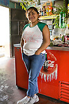 Young Guatemalan woman in her parents cafe, Quetzaltenango (Xela), Western Highlands, Guatemala