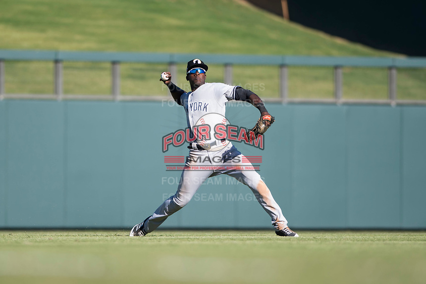 Glendale Desert Dogs left fielder Estevan Florial (13), of the New York Yankees organization, throws to second base during an Arizona Fall League game against the Salt River Rafters at Salt River Fields at Talking Stick on October 31, 2018 in Scottsdale, Arizona. Glendale defeated Salt River 12-6 in extra innings. (Zachary Lucy/Four Seam Images)