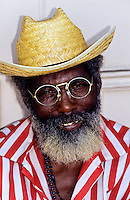 Portrait of an afroamerican with a strawhat and glasses in New Orleans, Louisiana, USA