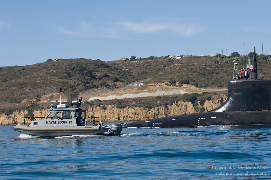 San Diego Bay, San Diego, California; US Navy submarine heading out to sea from the Sub Base at Point Loma, accompanied by US Navy Security boats