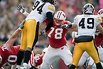 October 17, 2009: Wisconsin Badgers offensive lineman Jake Bscherer (78) blocks during an NCAA football game against the Iowa Hawkeyes at Camp Randall Stadium on October 17, 2009 in Madison, Wisconsin. The Hawkeyes won 20-10. (Photo by David Stluka)