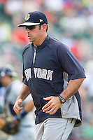 Charleston RiverDogs pitching coach Carlos Chantres (33) jogs off the field during the game against the Hickory Crawdads at L.P. Frans Stadium on May 25, 2014 in Hickory, North Carolina.  The RiverDogs defeated the Crawdads 17-10.  (Brian Westerholt/Four Seam Images)