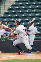 Dustin Fowler (18) of the Charleston RiverDogs follows through on his swing against the Hickory Crawdads at L.P. Frans Stadium on May 25, 2014 in Hickory, North Carolina.  The RiverDogs defeated the Crawdads 17-10.  (Brian Westerholt/Four Seam Images)