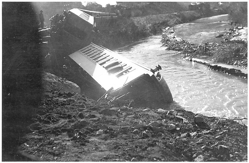 A passenger car derailment on a trestle along the San Juan River has put one car in the water and another off the track.<br /> D&amp;RG  near Pagosa Junction, CO  1911