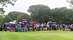CROMWELL, CT. 20 June 2019-062019 - Spectators put up their umbrellas as heavy rain begins to fall, during the first round of the Travelers Championship at TPC River Highlands in Cromwell on Thursday. Bill Shettle Republican-American